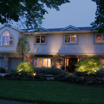 Home lit up with Landscape Lighting