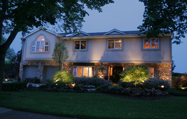 Home lit up with Landscape Lighting