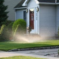 Automatic Sprinkler on the Front Lawn of a House