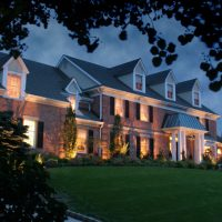 A house with landscape lighting in MA