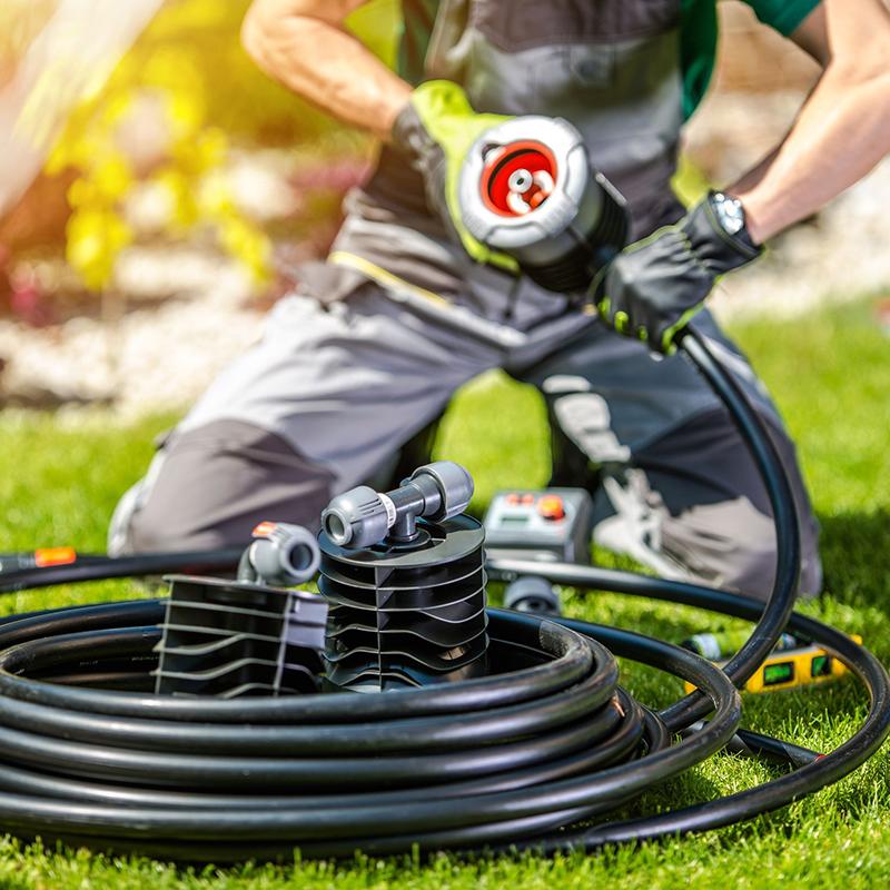 man installing sprinkler system
